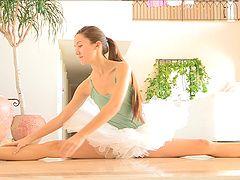 Hot ballerina spreads her legs...