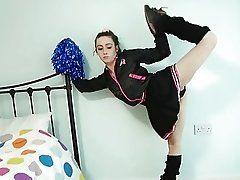 Flexible cheerleader poses naked...