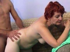 Redhead Granny seduces cute...