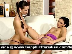 Sexy brunette lesbos fingering...